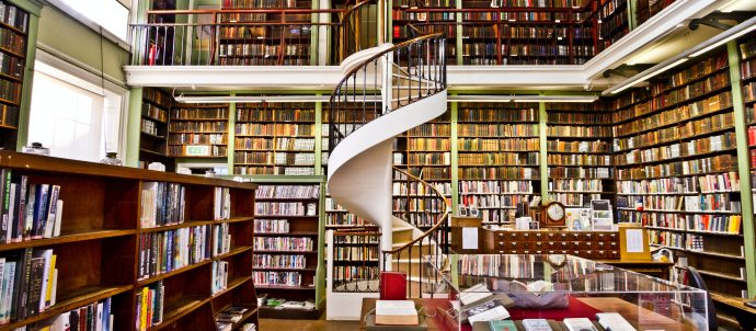 Library shelves with spiral staircase